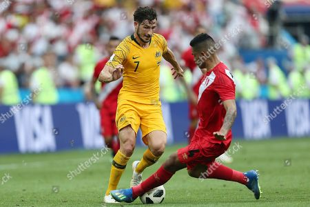 Matthew Leckie of Australia is tackled by Paolo Hurtado of Peru
