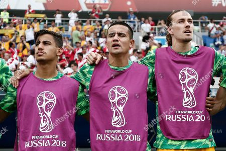 Daniel Arzani, Tim Cahill and Milos Degenek of Australia stand for the national anthem