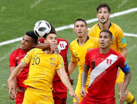 Peru's Anderson Santamaria, left, and Australia's Trent Sainsbury jump for the ball during the group C match between Australia and Peru, at the 2018 soccer World Cup in the Fisht Stadium in Sochi, Russia