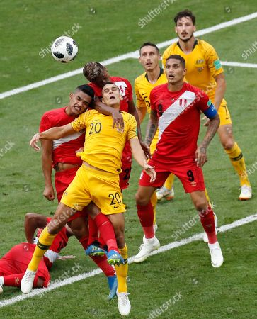 Peru's Anderson Santamaria, left, Peru's Pedro Aquino, second left, and Australia's Trent Sainsbury jump for the ball during the group C match between Australia and Peru, at the 2018 soccer World Cup in the Fisht Stadium in Sochi, Russia