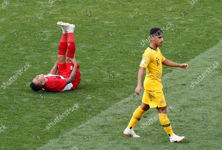 Peru's Christian Cueva lies on the floor as Australia's Daniel Arzani looks on during the group C match between Australia and Peru, at the 2018 soccer World Cup in the Fisht Stadium in Sochi, Russia