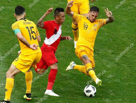 Australia's Mile Jedinak, left, Australia's Joshua Risdon and Peru's Christian Cueva, centre, challenge for the ball during the group C match between Australia and Peru, at the 2018 soccer World Cup in the Fisht Stadium in Sochi, Russia