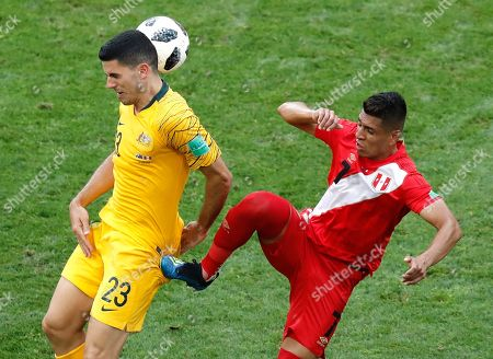 Australia's Tom Rogic, left, and Peru's Paolo Hurtado challenge for the ball during the group C match between Australia and Peru, at the 2018 soccer World Cup in the Fisht Stadium in Sochi, Russia