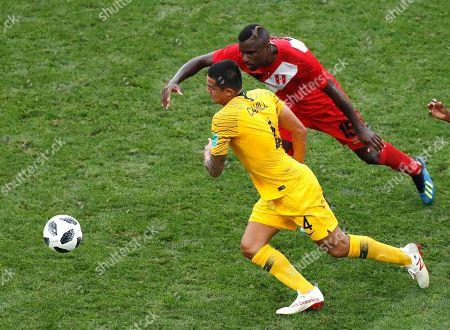Australia's Tim Cahill and Peru's Christian Ramos challenge for the ball during the group C match between Australia and Peru, at the 2018 soccer World Cup in the Fisht Stadium in Sochi, Russia