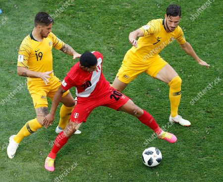 Australia's Joshua Risdon, left, Australia's Mathew Leckie, right, Peru's Edison Flores challenge for the ball during the group C match between Australia and Peru, at the 2018 soccer World Cup in the Fisht Stadium in Sochi, Russia