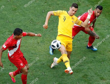 Peru's Edison Flores, left, Peru's Miguel Trauco, right, and Australia's Tomi Juric challenge for the ball during the group C match between Australia and Peru, at the 2018 soccer World Cup in the Fisht Stadium in Sochi, Russia