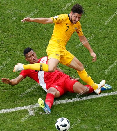 Australia's Tim Cahill, right, and Peru's Anderson Santamaria challenge for the ball during the group C match between Australia and Peru, at the 2018 soccer World Cup in the Fisht Stadium in Sochi, Russia