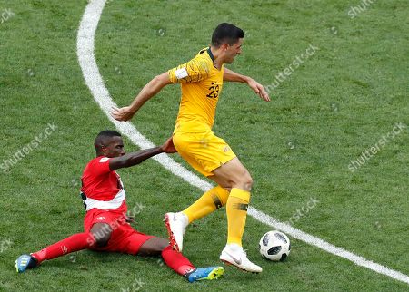 Australia's Tom Rogic, right, and Peru's Christian Ramos challenge for the ball during the group C match between Australia and Peru, at the 2018 soccer World Cup in the Fisht Stadium in Sochi, Russia
