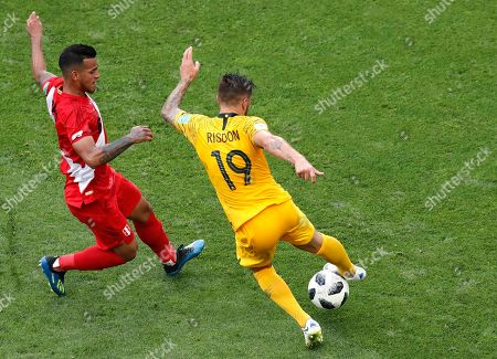 Peru's Miguel Trauco, left, and Australia's Joshua Risdon challenge for the ball during the group C match between Australia and Peru, at the 2018 soccer World Cup in the Fisht Stadium in Sochi, Russia