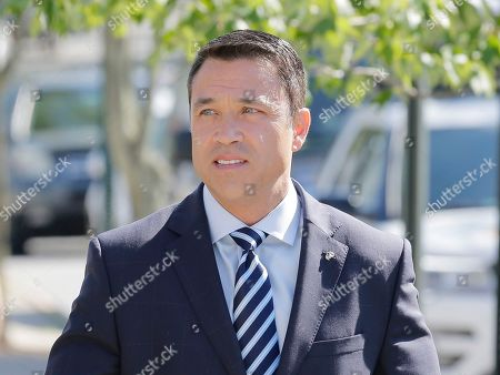 Former U.S. Rep. Michael Grimm arrives to his polling site in the Staten Island borough of New York, . New York City's only Republican congressman, U.S. Rep. Daniel Donovan, will try to hold off a fierce challenge in the state's primary election Tuesday from former U.S. Rep. Michael Grimm, who is trying to make a political comeback after serving prison time for tax fraud