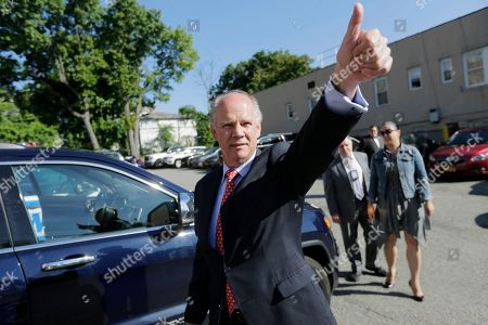 Stock Photo of U.S. Rep. Daniel Donovan gives a thumbs up after voting in the Staten Island borough of New York, . New York City's only Republican congressman, Donovan, will try to hold off a fierce challenge in the state's primary election Tuesday from former U.S. Rep. Michael Grimm, who is trying to make a political comeback after serving prison time for tax fraud