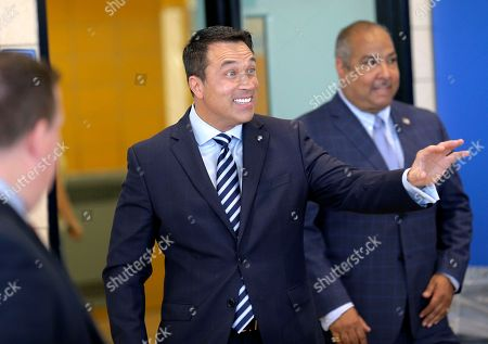Former U.S. Rep. Michael Grimm arrives to his polling site in the Staten Island borough of New York, . New York City's only Republican congressman, U.S. Rep. Daniel Donovan, will try to hold off a fierce challenge in the state's primary election Tuesday from Grimm, who is trying to make a political comeback after serving prison time for tax fraud