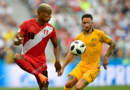 Peru's Andre Carrillo, left, and Australia's Joshua Risdon challenge for the ball during the group C match between Australia and Peru, at the 2018 soccer World Cup in the Fisht Stadium in Sochi, Russia