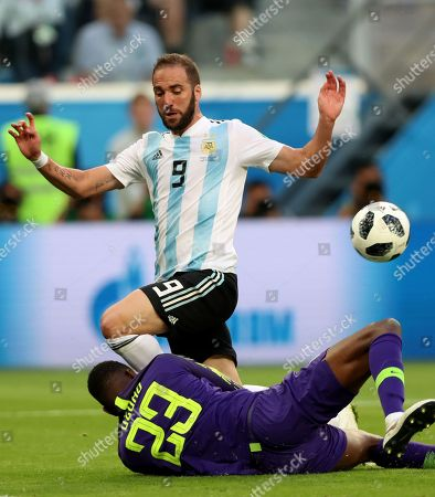 Goalkeeper Francis Uzoho (down) of Nigeria and Gonzalo Higuain of Argentina in action during the FIFA World Cup 2018 group D preliminary round soccer match between Nigeria and Argentina in St.Petersburg, Russia, 26 June 2018. (RESTRICTIONS APPLY: Editorial Use Only, not used in association with any commercial entity - Images must not be used in any form of alert service or push service of any kind including via mobile alert services, downloads to mobile devices or MMS messaging - Images must appear as still images and must not emulate match action video footage - No alteration is made to, and no text or image is superimposed over, any published image which: (a) intentionally obscures or removes a sponsor identification image; or (b) adds or overlays the commercial identification of any third party which is not officially associated with the FIFA World Cup)