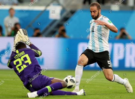 Goalkeeper Francis Uzoho (L) of Nigeria and Gonzalo Higuain of Argentina in action during the FIFA World Cup 2018 group D preliminary round soccer match between Nigeria and Argentina in St.Petersburg, Russia, 26 June 2018. (RESTRICTIONS APPLY: Editorial Use Only, not used in association with any commercial entity - Images must not be used in any form of alert service or push service of any kind including via mobile alert services, downloads to mobile devices or MMS messaging - Images must appear as still images and must not emulate match action video footage - No alteration is made to, and no text or image is superimposed over, any published image which: (a) intentionally obscures or removes a sponsor identification image; or (b) adds or overlays the commercial identification of any third party which is not officially associated with the FIFA World Cup)