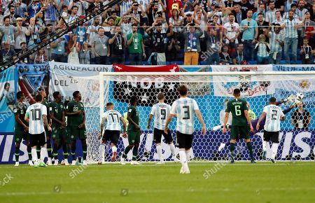 Lionel Messi of Argentina and Goalkeeper Francis Uzoho of Nigeria
