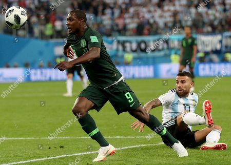Odion Ighalo (L) of Nigeria and Nicolas Otamendi of Argentina in action during the FIFA World Cup 2018 group D preliminary round soccer match between Nigeria and Argentina in St.Petersburg, Russia, 26 June 2018. (RESTRICTIONS APPLY: Editorial Use Only, not used in association with any commercial entity - Images must not be used in any form of alert service or push service of any kind including via mobile alert services, downloads to mobile devices or MMS messaging - Images must appear as still images and must not emulate match action video footage - No alteration is made to, and no text or image is superimposed over, any published image which: (a) intentionally obscures or removes a sponsor identification image; or (b) adds or overlays the commercial identification of any third party which is not officially associated with the FIFA World Cup)