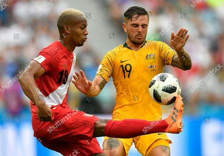 Stock Image of Peru's Andre Carrillo, left, and Australia's Joshua Risdon challenge for the ball during the group C match between Australia and Peru, at the 2018 soccer World Cup in the Fisht Stadium in Sochi, Russia