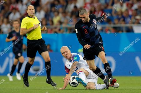 Croatia's Mateo Kovacic, right, duels for the ball with Iceland's Emil Hallfredsson during the group D match between Iceland and Croatia, at the 2018 soccer World Cup in the Rostov Arena in Rostov-on-Don, Russia