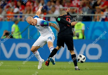Iceland's Emil Hallfredsson, left, duels for the ball with Croatia's Mateo Kovacic during the group D match between Iceland and Croatia, at the 2018 soccer World Cup in the Rostov Arena in Rostov-on-Don, Russia