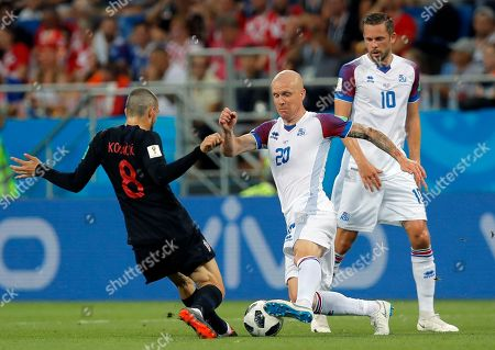 Croatia's Mateo Kovacic, left, duels for the ball with Iceland's Emil Hallfredsson during the group D match between Iceland and Croatia, at the 2018 soccer World Cup in the Rostov Arena in Rostov-on-Don, Russia