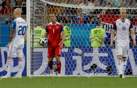 From left, Iceland's Emil Hallfredsson, goalkeeper Hannes Halldorsson and Hordur Magnusson react after Croatia's Milan Badelj scored his side's first goal during the group D match between Iceland and Croatia, at the 2018 soccer World Cup in the Rostov Arena in Rostov-on-Don, Russia