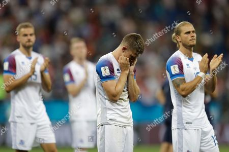 From left, Iceland's Holmar Eyjolfsson, Johann Gudmundsson and Rurik Gislason leave the pitch at the end of the group D match between Iceland and Croatia, at the 2018 soccer World Cup in the Rostov Arena in Rostov-on-Don, Russia, .Croatia won 2-1
