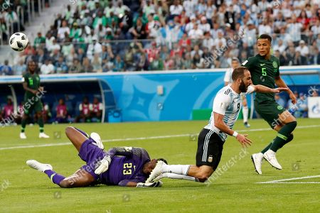 Argentina's Gonzalo Higuain, right, collides with Nigeria goalkeeper Francis Uzoho during the group D match between Argentina and Nigeria, at the 2018 soccer World Cup in the St. Petersburg Stadium in St. Petersburg, Russia