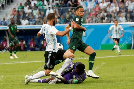 Stock Image of Argentina's Gonzalo Higuain, left, collides with Nigeria goalkeeper Francis Uzoho during the group D match between Argentina and Nigeria, at the 2018 soccer World Cup in the St. Petersburg Stadium in St. Petersburg, Russia