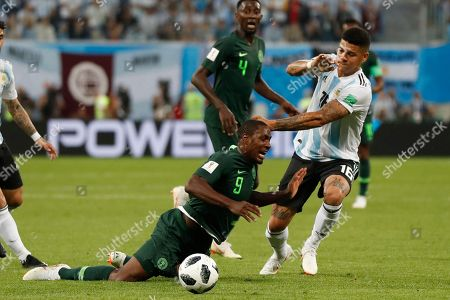 Argentina's Marcos Rojo, right, stops Nigeria's Odion Ighalo during the group D match between Argentina and Nigeria, at the 2018 soccer World Cup in the St. Petersburg Stadium in St. Petersburg, Russia