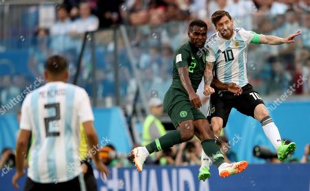 Lionel Messi of Argentina and Brian Idowu of Nigeria compete in the air