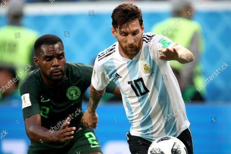 Brian Idowu of Nigeria and Lionel Messi of Argentina