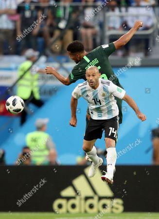 Javier Mascherano of Argentina and William Troost-Ekong of Nigeria
