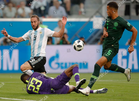 Nigeria goalkeeper Francis Uzoho, left, saves on an attempt to score by Argentina's Gonzalo Higuain during the group D match between Argentina and Nigeria, at the 2018 soccer World Cup in the St. Petersburg Stadium in St. Petersburg, Russia