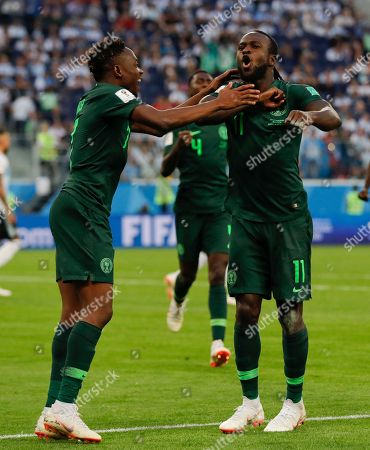 Nigeria's Victor Moses, right, celebrates with his teammate Ahmed Musa after scoring his side first goal on a penalty during the group D match between Argentina and Nigeria, at the 2018 soccer World Cup in the St. Petersburg Stadium in St. Petersburg, Russia