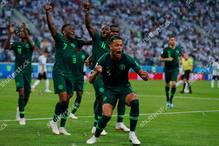 Nigeria's Victor Moses, center, celebrates with his teammates Ahmed Musa, left, Bryan Idowu and William Ekong, right, after scoring his side first goal on a penalty during the group D match between Argentina and Nigeria, at the 2018 soccer World Cup in the St. Petersburg Stadium in St. Petersburg, Russia
