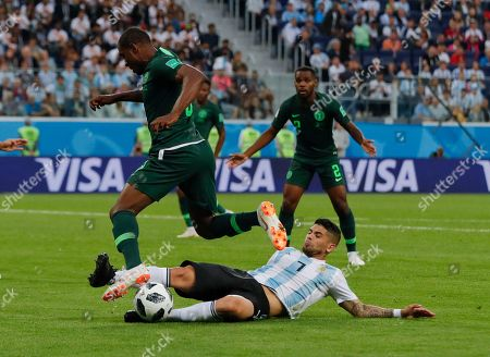 Nigeria's Odion Ighalo, left, is tackled by Argentina's Ever Banega during the group D match between Argentina and Nigeria, at the 2018 soccer World Cup in the St. Petersburg Stadium in St. Petersburg, Russia