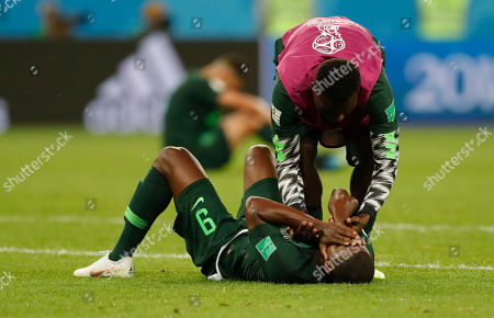 Nigeria's Odion Ighalo cries at the end of the group D match between Argentina and Nigeria, at the 2018 soccer World Cup in the St. Petersburg Stadium in St. Petersburg, Russia, . Argentina won 2-1