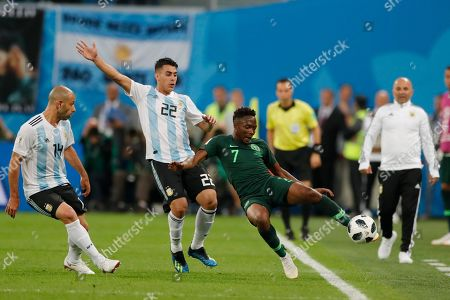 Nigeria's Ahmed Musa, right, plays the ball challenged by Argentina's Cristian Pavon during the group D match between Argentina and Nigeria, at the 2018 soccer World Cup in the St. Petersburg Stadium in St. Petersburg, Russia