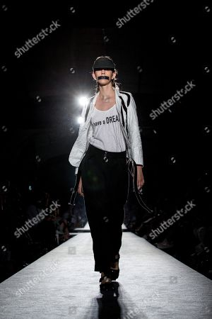 Stock Image of A model presents a creation by Spanish designer Miriam Ponsa during the 080 Barcelona Fashion week, in Barcelona, Spain, 26 June 2018. The 080 Barcelona Fashion event runs from 25 to 29 June.
