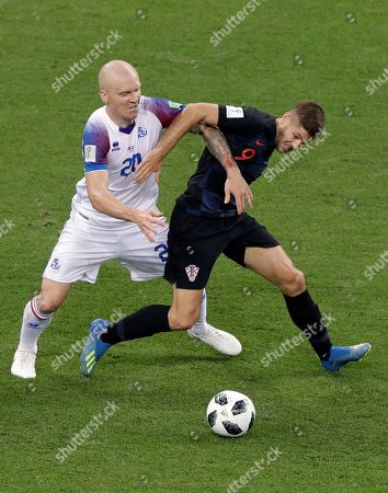 Iceland's Emil Hallfredsson, left, tussles for the ball with Croatia's Andrej Kramaric during the group D match between Iceland and Croatia, at the 2018 soccer World Cup in the Rostov Arena in Rostov-on-Don, Russia