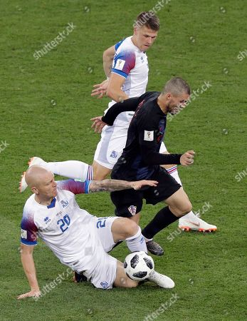 Iceland's Emil Hallfredsson, left, clears a ball from Croatia's Mateo Kovacic, right, during the group D match between Iceland and Croatia, at the 2018 soccer World Cup in the Rostov Arena in Rostov-on-Don, Russia