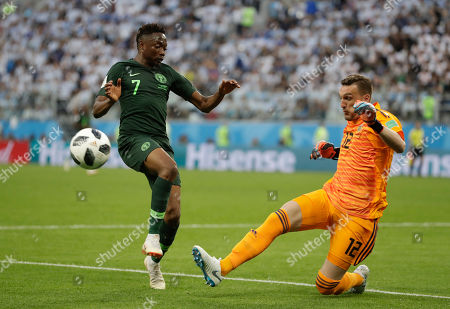 Ahmed Musa, Franco Armani. Nigeria's Ahmed Musa, left, and Argentina goalkeeper Franco Armani compete for the ball during the group D match between Argentina and Nigeria at the 2018 soccer World Cup in the St. Petersburg Stadium in St. Petersburg, Russia