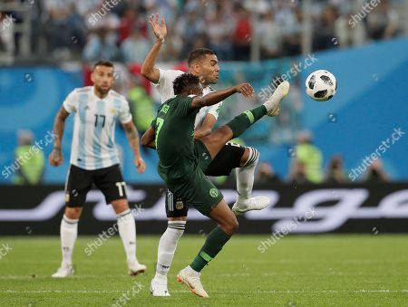Ahmed Musa, Gabriel Mercado. Nigeria's Ahmed Musa, front, and Argentina's Gabriel Mercado compete for the ball during the group D match between Argentina and Nigeria at the 2018 soccer World Cup in the St. Petersburg Stadium in St. Petersburg, Russia