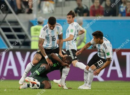 Odion Ighalo, Marcos Rojo, Maximiliano Meza. Nigeria's Odion Ighalo, bottom, competes for the ball with Argentina's Marcos Rojo and Argentina's Maximiliano Meza during the group D match between Argentina and Nigeria at the 2018 soccer World Cup in the St. Petersburg Stadium in St. Petersburg, Russia