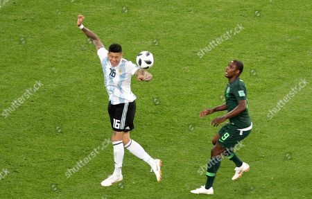 The ball touches the arm of Argentina's Marcos Rojo in front of Nigeria's Odion Ighalo in the box during the group D match between Argentina and Nigeria, at the 2018 soccer World Cup in the St. Petersburg Stadium in St. Petersburg, Russia