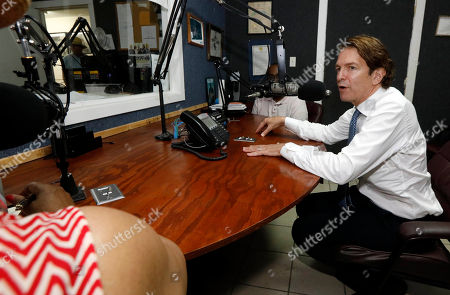 Stock Photo of Democratic Senatorial runoff candidate Howard Sherman, answers a question from radio host Eddie Jean Carr, left, as he makes a last minute campaign stop at radio station WMPR in Jackson, Miss., . Sherman seeks the right to face incumbent Republican U.S. Sen. Roger Wicker and a couple of independents in the general election
