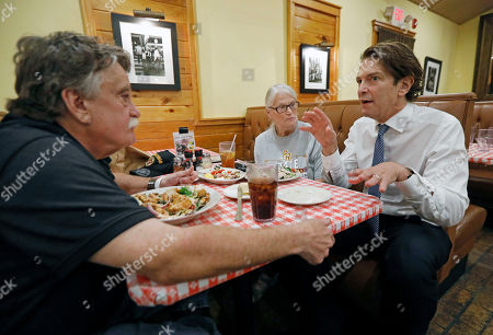 Democratic Senatorial runoff candidate Howard Sherman, right, speaks with Janna Avalon, center and her husband Billy Avalon of Jackson, Miss., as he campaigns in a Jackson, Miss., restaurant, . If Sherman wins the party nomination, he will face incumbent Republican U.S. Sen. Roger Wicker and a couple of independents in the general election