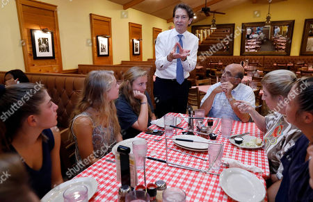 Stock Picture of Democratic Senatorial runoff candidate Howard Sherman, speaks with a family as he campaigns in a Jackson, Miss., restaurant, . If Sherman wins the party nomination, he will face incumbent Republican U.S. Sen. Roger Wicker and a couple of independents in the general election