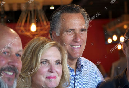 Mitt Ann Romney. Mitt and Ann Romney poses for photographs during a campaign stop at the R&R BBQ restaurant, in South Jordan, Utah. Utah's primary election will give former GOP presidential nominee Romney a second chance against state lawmaker Mike Kennedy who defeated him at the party convention in his bid replace retiring U.S. Sen. Orrin Hatch